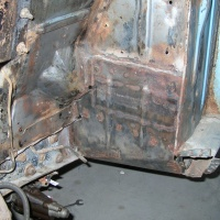Rust and repair of the driver's side torque box.