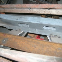 Common rust in the radiator core support caused by battery acid.